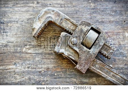 Old Rustic Wrench On Wood