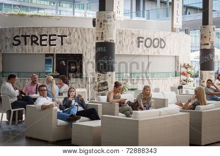 People Resting At Homi, Home International Show In Milan, Italy