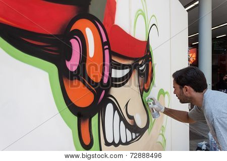 Artist Kayone Performing At Homi, Home International Show In Milan, Italy