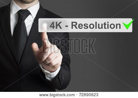Businessman Pushing Touchscreen Button 4K Resolution