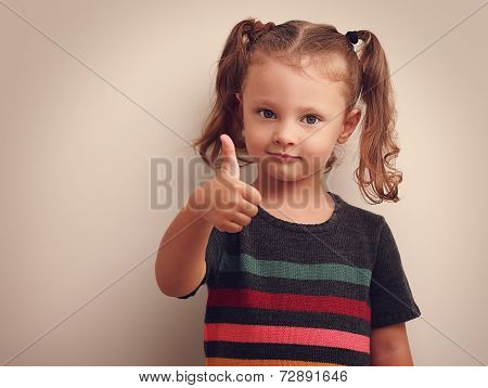 Beautiful Smiling Small Kid Girl Showing Thumb Up. Vintage Portrait