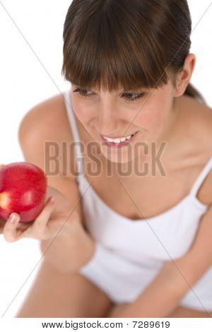 Female Teenager Eat Apple For Breakfast