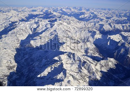 Alpine mountain ridge in winter, aerial view