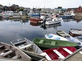 pic of lobster boat  - Boats in the still waters of Rockport Harbor Massachusetts - JPG
