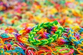 stock photo of rubber band  - Colorful Rainbow loom bracelet rubber bands - JPG