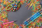stock photo of loom  - Colorful of elastic rainbow loom bands tool - JPG