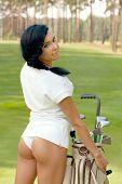 image of flirty  - Attractive brunette golfer girl on golf course - JPG