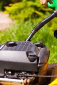 picture of petrol  - Petrol filling the flue lawn mower - JPG