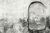 picture of niche  - the old plastered surface of a wall of the ancient building with an architectural element of a niche in monochrome tones - JPG