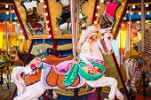 stock photo of carnival ride  - Colorful wood carousel horse at a carnival [[** Note: Shallow depth of field ** Note: Visible grain at 100%, best at smaller sizes - JPG