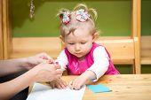 foto of montessori school  - Mother and child girl playing in kindergarten in Montessori preschool Class - JPG
