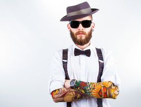 stock photo of suspenders  - young hipster man wearing hat suspenders bow - JPG