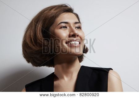 Woman With A Natural Makeup Is Smiling