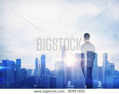 Double Exposure Of A Businessman And Megalopolis