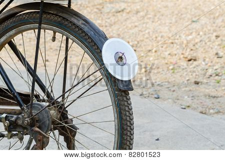 close-up back wheel of bicycle with CD disc as reflector