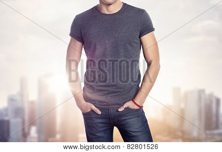 Man Wearing Blank T-shirt On Blurred Megalopolis Background
