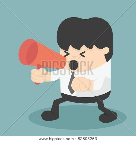 Businessman With Clenched Fist Screaming Into A Megaphone