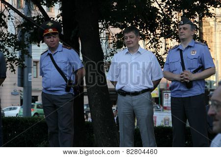 Police Officers In A Form And In Civil Clothes On Oppositional Meeting