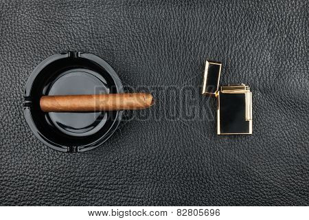 Lighter And Black Ashtray With Cigar