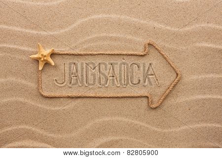 Arrow Made Of Rope And Sea Shells With The Word Jamaica On The Sand