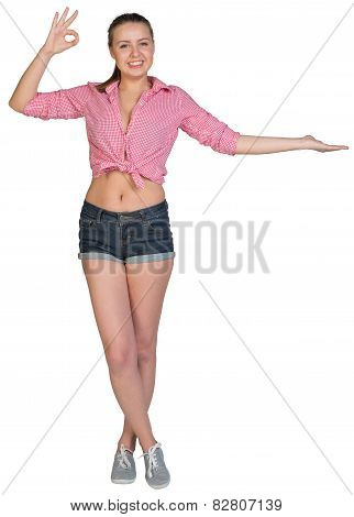 Woman showing something on her palm, making okay gesture