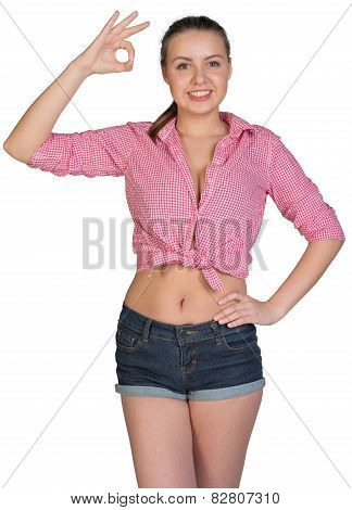 Woman making okay gesture