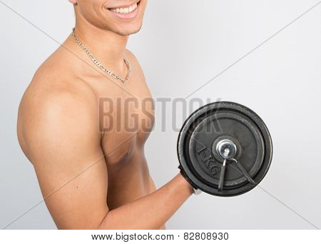 Handsome Young Muscular Sportsman Execute Exercise With Dumbbells