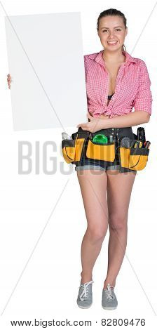 Woman in tool belt showing blank banner
