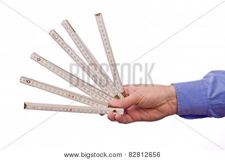 Male Worker's Hand Holding Wooden Meter