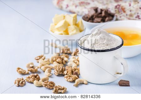 Cup Of Flour, Eggs, Butter, Nuts And Chocolate Chunks