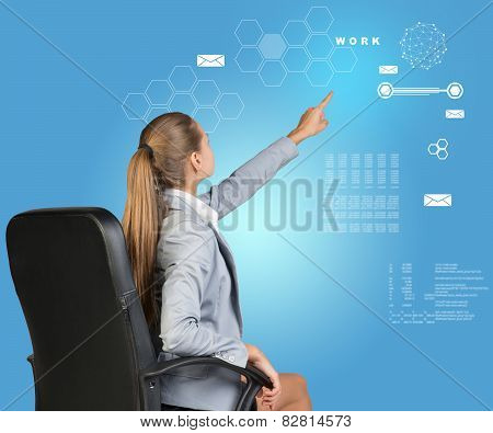 Businesswoman pressing virtual interface