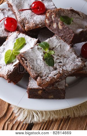 Chocolate Cake Brownie With Walnuts Close-up. Vertical