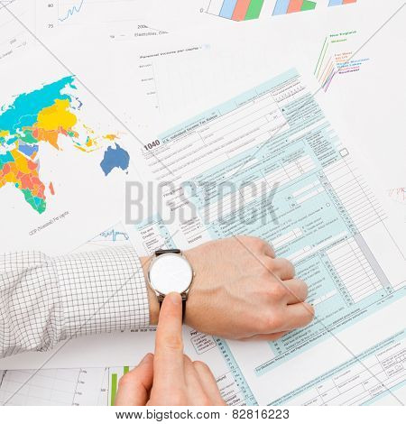 Male Filling Out 1040 Us Tax Form - Tax Time