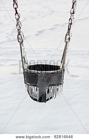 Ice Covered Playground Swing Seat