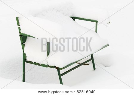 Snow-covered park bench
