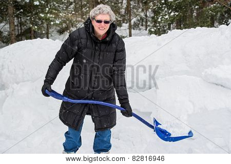 Senior Woman Shoveling Snow