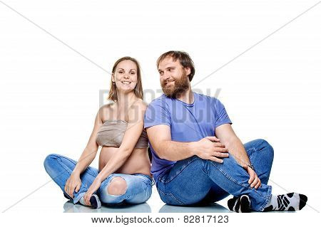 young family waiting for baby on a white background