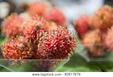 Detail Of Rambutan Fruit On Market Shelf
