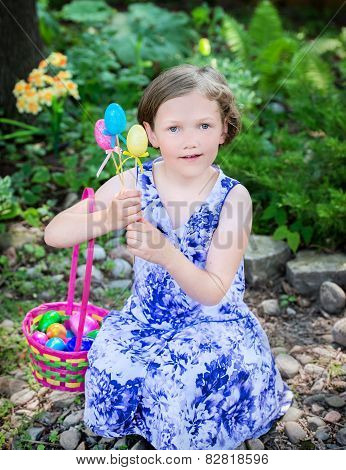 Young Girl With Easter Eggs And Basket