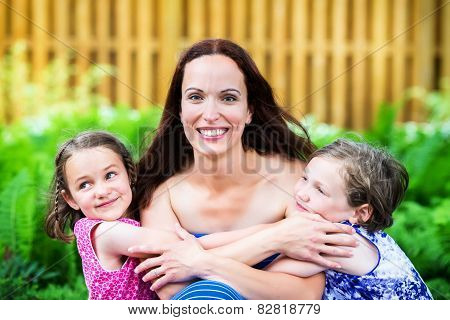 Mother And Her Two Daughters Together