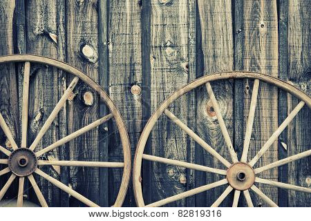 Close Up Of Two Wagon Wheels - Retro