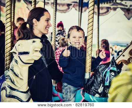Happy Boy And Mother On Carousel - Retro