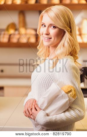 Beautiful young woman at bakers shop
