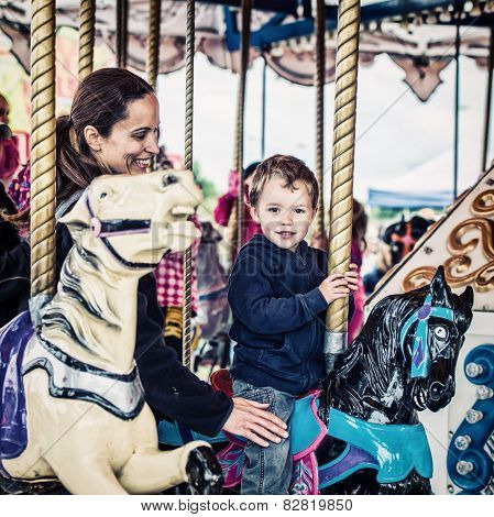Boy And Mother On Carousel Together - Retro