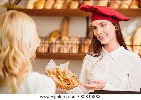 Beautiful young woman at bakers shop