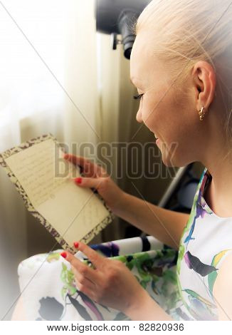 Young Woman reading letter