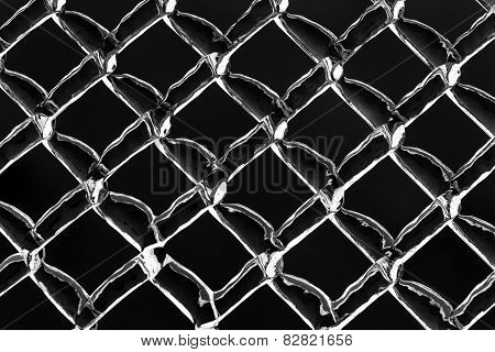 Thick Frozen Ice On A Metal Chain Link Fence - Inverted