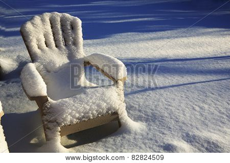 Snow Covered Chair