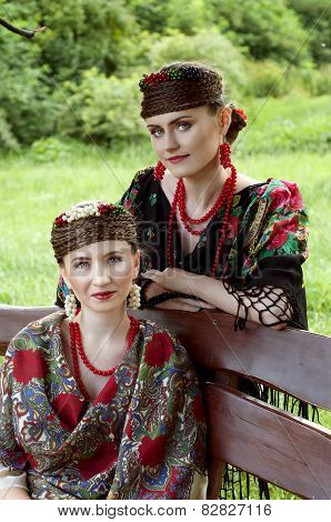 Two Caucasian Slavonic Women Sitting On The Bench
