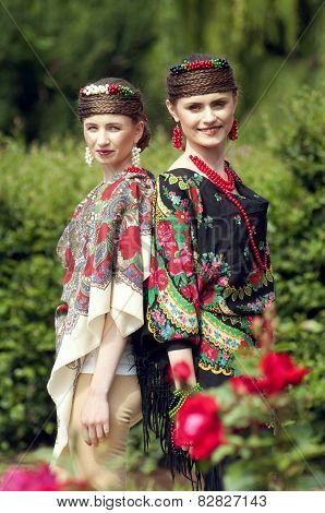 Two Caucasian Slavonic Women  In The Field Of Flowers